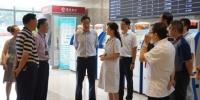 黄明会督导部分公立医院机构首个就诊高峰日运行情况 - 卫生厅
