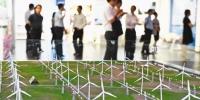 七月九日,重庆市党政代表团来到东方电气集团中央研究院考察产业升级发展情况。四川日报记者 李向雨 摄 - 重庆新闻网